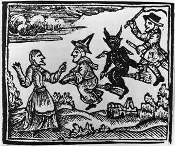 a black and white illustration of witches flying on brooms