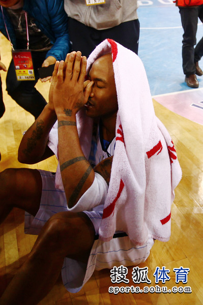 March 30th, 2012 - Stephon Marbury prays after winning the CBA Championship for the Beijing Ducks