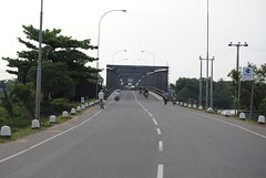 junction(0.0), controlled-access highway(0.0), residential area(0.0), overpass(0.0), intersection(0.0), asphalt(1.0), highway(1.0), road(1.0), lane(1.0), shoulder(1.0), road surface(1.0), street(1.0), infrastructure(1.0),