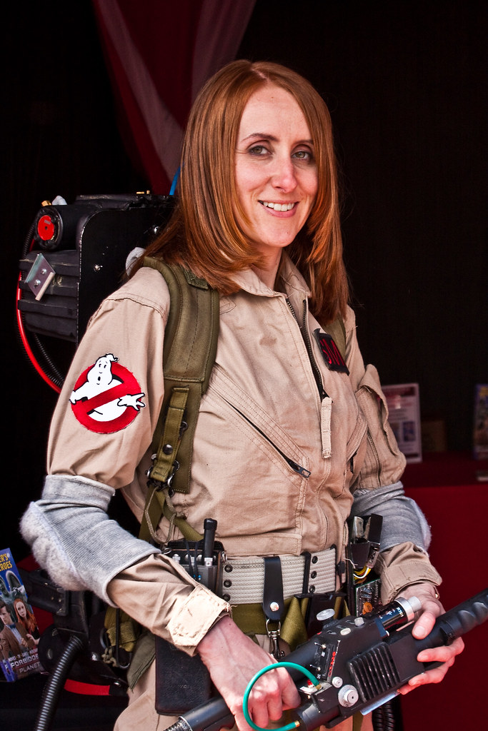 a woman cosplaying as a ghostbuster