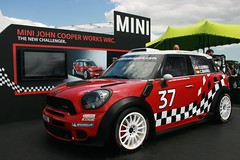 family car(0.0), automobile(1.0), mini cooper(1.0), automotive exterior(1.0), racing(1.0), vehicle(1.0), automotive design(1.0), mini e(1.0), mini(1.0), rallycross(1.0), subcompact car(1.0), city car(1.0), land vehicle(1.0), luxury vehicle(1.0), motor vehicle(1.0),