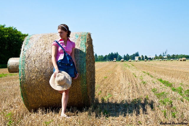 Peasant girl in straw field