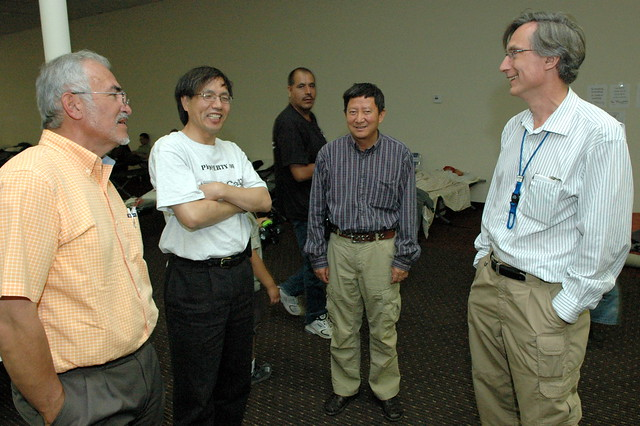 Rich Marquez (far left) and Charlie McMillan (far right) visit with William Dai (left) and Xia Ma at the Santa Claran Hotel in Espanola.    Photo by Kevin Roark.
