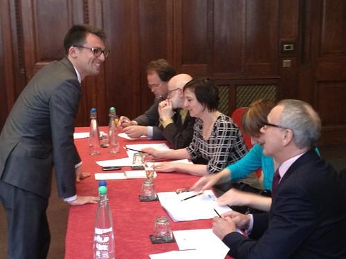 David greets panel members