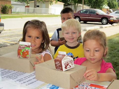 Children in Cook County, Illinois, enjoy a nutritious summer meal from the Greater Chicago Food Depository's Lunch Bus.