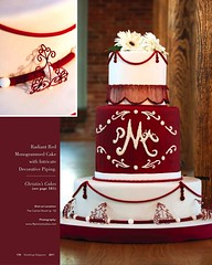 Radiant Red Monogramed Cake with Intricate Decorative Piping