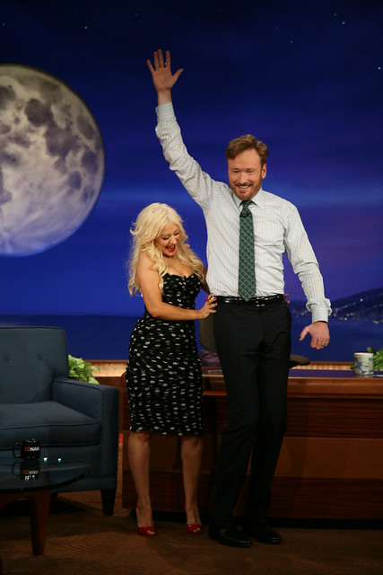 Conan O'Brien dances with Christina Aguilera.