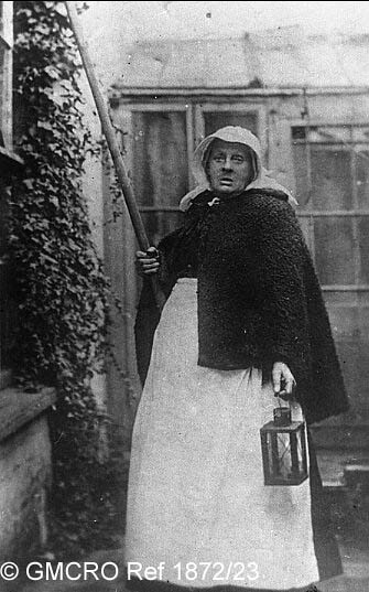 "Grannie Cousins"", the local 'Knocker up' in c.1912. (GB124.DPA/1872/23)."