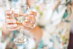 meal(0.0), yellow(0.0), wedding(0.0), party(0.0), centrepiece(0.0), baby shower(0.0), rehearsal dinner(0.0), ceremony(0.0), wine glass(1.0), close-up(1.0), blue(1.0),