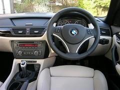 automotive exterior(0.0), wheel(0.0), bmw x5(0.0), automobile(1.0), vehicle(1.0), automotive design(1.0), bmw x1(1.0), personal luxury car(1.0), land vehicle(1.0), luxury vehicle(1.0),