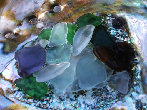 Sea glass on an abalone shell
