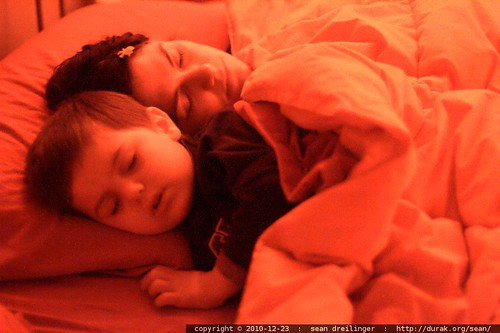 sleeping beauties   mother and son asleep in bed