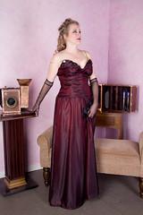 bridal clothing(0.0), purple(0.0), little black dress(0.0), quinceaã±era(0.0), bridesmaid(0.0), prom(0.0), bridal party dress(1.0), neck(1.0), textile(1.0), magenta(1.0), gown(1.0), clothing(1.0), cocktail dress(1.0), maroon(1.0), woman(1.0), female(1.0), satin(1.0), formal wear(1.0), human body(1.0), wedding dress(1.0), pink(1.0), dress(1.0),