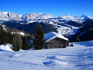Chalet near Colfosco and the Dolomites as background