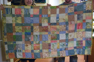 We never manage to hold these up straight, but you get the idea. Adelyn's baby quilt, Speed Racer, after a year of use. It's much softer now!