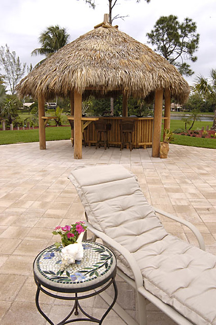 Backyard with tiki hut explore for Small garden huts