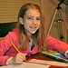 Small photo of Elementary Girl doing homework