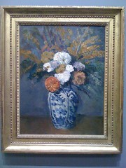needlework(0.0), embroidery(0.0), cross-stitch(0.0), art(1.0), flower(1.0), picture frame(1.0), painting(1.0), still life(1.0),