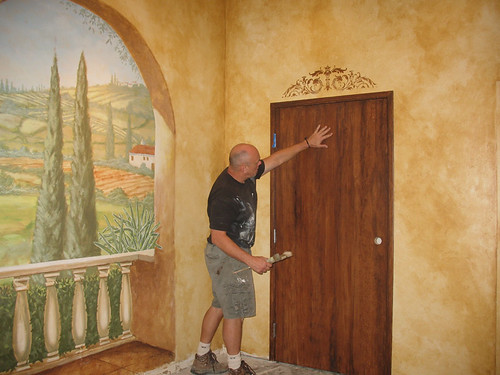 Wood -graining a door next to the mural