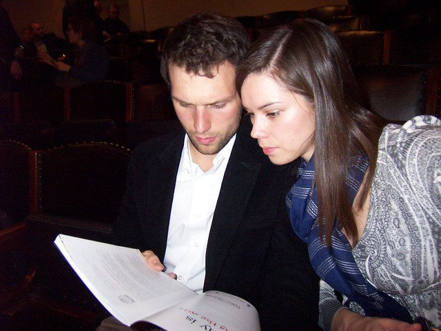 ian and anna look at the program