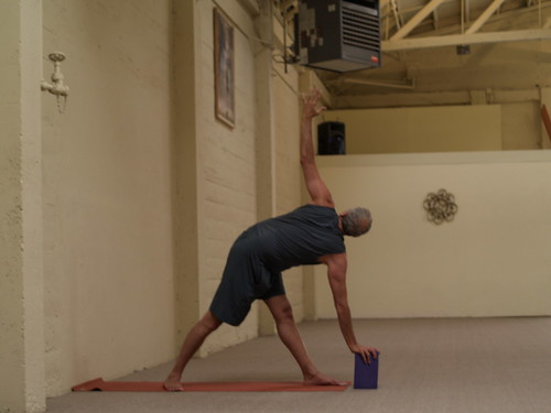 Twisted Triangle Pose with the help of a Foam Block