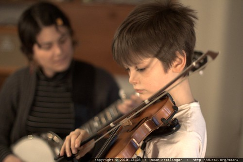 nick plays violin while his mom plays banjo