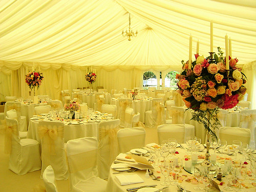 Roses centerpiece with candles inside wedding marquee