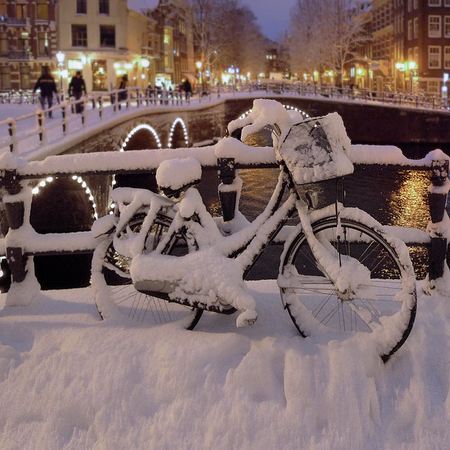 Snow covered bike in the heart of Amsterdam