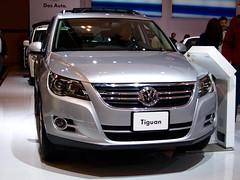volkswagen cc(0.0), volkswagen passat(0.0), automobile(1.0), automotive exterior(1.0), exhibition(1.0), volkswagen tiguan(1.0), executive car(1.0), wheel(1.0), volkswagen(1.0), vehicle(1.0), automotive design(1.0), auto show(1.0), mid-size car(1.0), crossover suv(1.0), bumper(1.0), land vehicle(1.0), luxury vehicle(1.0),