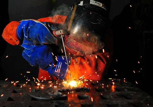 Sailor welding a flange.