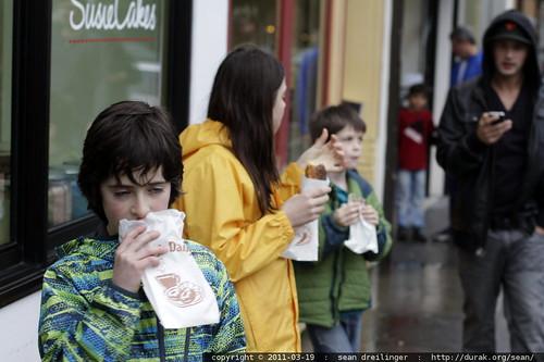 he's not huffing glue, he's eating a doughnut