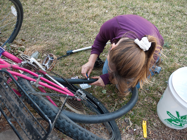 Kathy fixing a slow leak by Zane Selvans on flickr