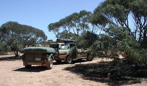 Mary peaks over Scruby at a stop for lunch on the Nullarbor past Mundrabilla        See my photos on a map of the Nullarbor..   http://loc.alize.us/#/user:spelio/geo:-30.477083,130.473633,7,k/