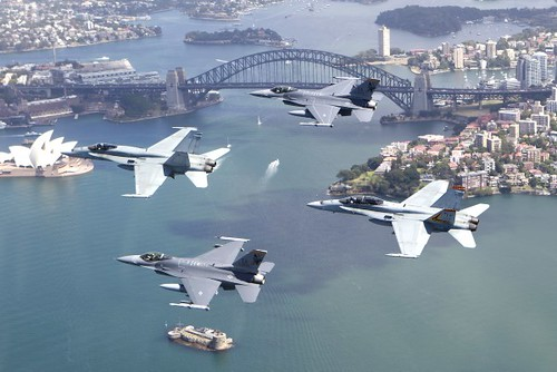 F/A-18 and F-16's fly in formation over Sydney, Australia