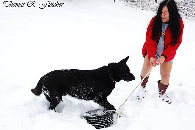 Mature Woman plays with German Shepherd