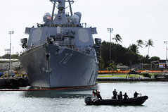 PEARL HARBOR (Feb. 23, 2011) Sailors aboard a rigid-hull inflated boat role-play as terrorists coming alongside USS Hopper (DDG 70) during the Solid Curtain-Citadel Shield 2011 exercise. (U.S. Navy photo by Mass Communication Specialist 2nd Class (SW) Mark Logico)