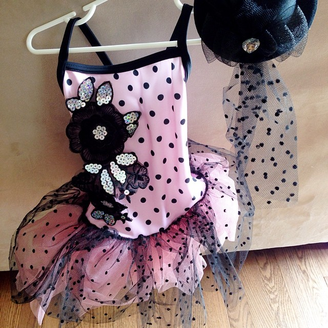"Just picked up Autumn's recital costume for dance. This is the cutest one yet, pink with black polka dots and the little top hat completes it! I die. Her song is, ""Getting to Know You""."