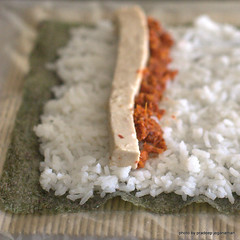 Nori sheet, spread with rice, jelled karavala and lunu-miris