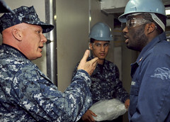 YOKOSUKA, Japan (Feb. 10, 2011) Pacific Fleet Master Chief John T. Minyard talks with Operations Specialist 3rd Class Aaron N'Diaye during a tour of aircraft carrier USS George Washington (CVN 73). (U.S. Navy Photo by Mass Communication Specialist Seaman Apprentice Alysia R. Hernandez)