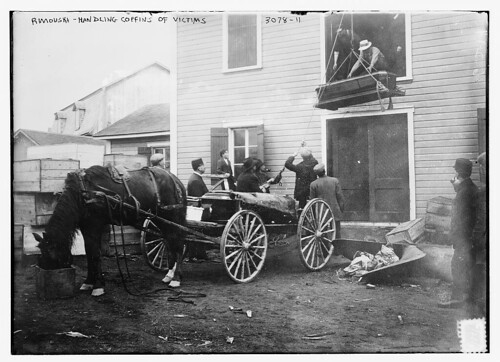 Rimouski -- handling coffins of victims  (LOC)