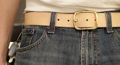 bag(0.0), handbag(0.0), zipper(0.0), denim(1.0), textile(1.0), brown(1.0), strap(1.0), leather(1.0), pocket(1.0), belt(1.0),