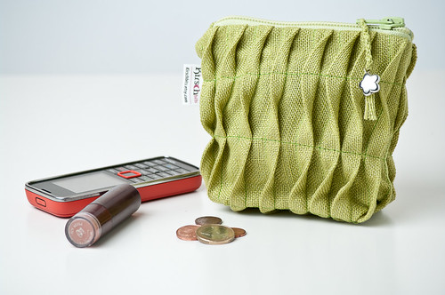 Husby, ruffled apple green zippered pouch.