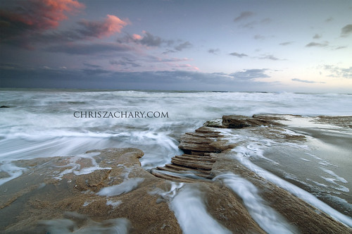 ocean longexposure sunset seascape beach landscapes nc rocks waves seascapes dramatic northcarolina carolinabeach fortfisher ndgrad nikond300 tokina1116mmf28