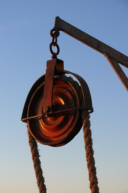 Red pulley (1) from Flickr via Wylio
