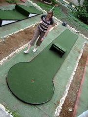 outdoor play equipment(0.0), swimming pool(0.0), grass(0.0), lawn(0.0), playground(0.0), backyard(1.0), sports(1.0), recreation(1.0), outdoor recreation(1.0), yard(1.0), green(1.0), golf(1.0), miniature golf(1.0),