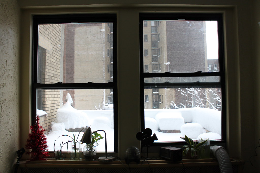 New York City apartment window during the winter snow blizzard of 2011