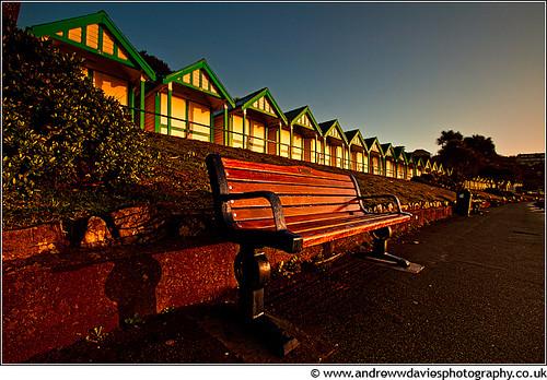 light beach southwales sunrise bench huts promenade gower canonefs1022mmf3545usm langlandbay coastuk canoneos7d andrewwilliamdavies