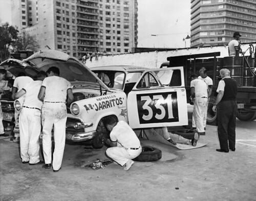 Mechanics working on race car at La Carrera Panamericana road race, Mexico, May 1954