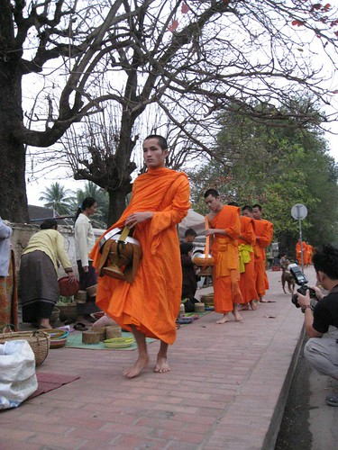 monks collecting merit contributions