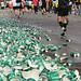 Cups pile up by a water station near Boston College late Monday afternoon as runners pass the Boston Marathon's 21-mile mark.  Photo by Andrew McFarland. BU News Service.